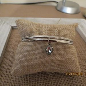 2 Silver Tone bangle bracelet 1 with dangling clea